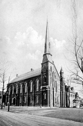 The Methodist Church On Spring Street Has Simplified Gothic Features Steeply Pitched Roof Slender Tower And Flying Buttress Decorations